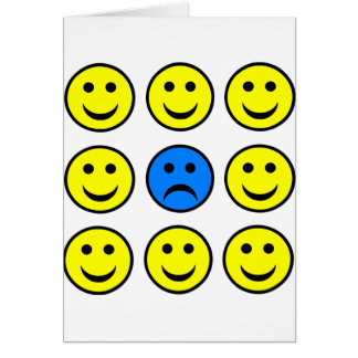 Sad Smiley Face in a Crowd of Happy Smilies Greeting Card