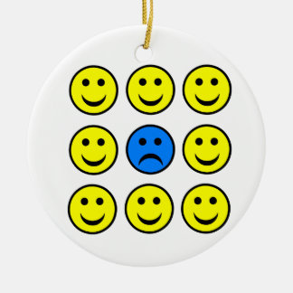 Sad Smiley Face in a Crowd of Happy Smilies Round Ceramic Decoration