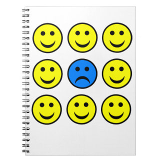 Sad Smiley Face in a Crowd of Happy Smilies Spiral Notebook