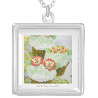 Safari animal party cupcakes. silver plated necklace
