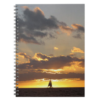 Sail boat at sunset notebooks