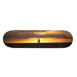 Sail boat at sunset skate board deck