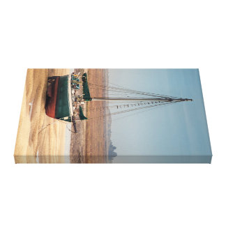 Sail boat stranded at low tide on beautiful sand canvas print