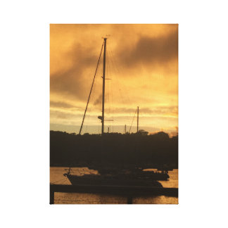 Sailboat at sunset canvas print