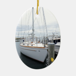 sailboat in harbor christmas ornament