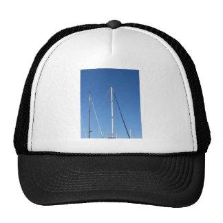 Sailboat masts in the marina against a blue sky cap