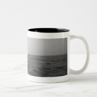 Sailboat on ocean Two-Tone coffee mug