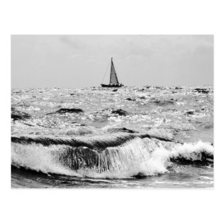 Sailing boat and a beautiful wave postcard
