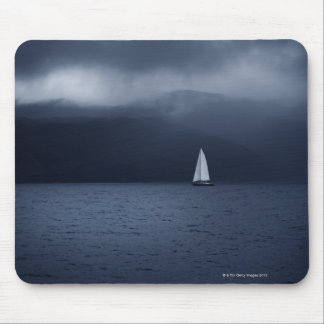 Sailing boat in stormy weather in Scottish Mouse Mat