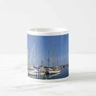 Sailing boats in the harbour coffee mug