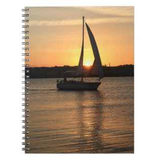 Sailing in Cardiff Bay at Sunset. Spiral Notebook