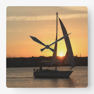 Sailing in Cardiff Bay at Sunset. Square Wall Clock