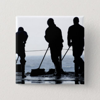 Sailors sweep out the hangar bay 15 cm square badge