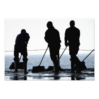 Sailors sweep out the hangar bay photo print