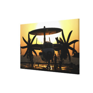 Sailors work on an E-2C Hawkeye aircraft Canvas Print
