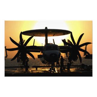 Sailors work on an E-2C Hawkeye aircraft Art Photo