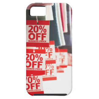 Sale tags attached to hanging clothes, close-up case for the iPhone 5