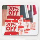Sale tags attached to hanging clothes, close-up mouse mat
