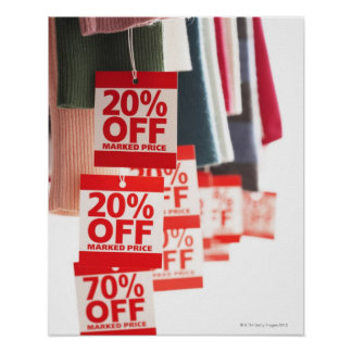 Sale tags attached to hanging clothes, close-up poster