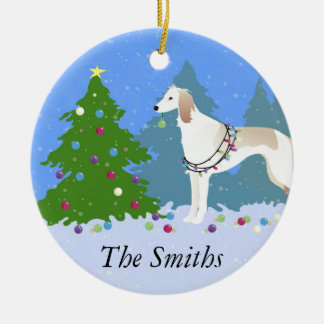 Saluki decorating a Christmas tree in the forest Round Ceramic Decoration