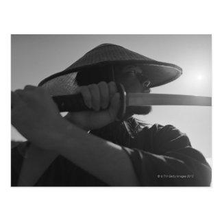 Samurai warrior holding a sword 2 postcard