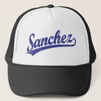 Sanchez script logo in blue trucker hat