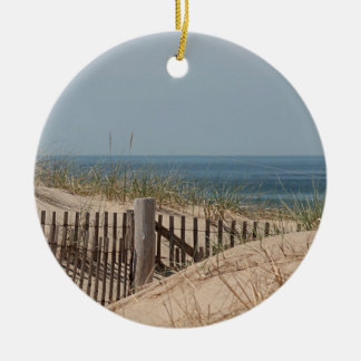 Sand dune, dune grass, and beach fence round ceramic decoration