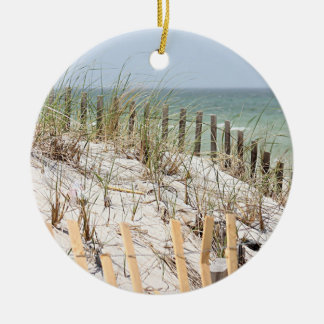 Sand dunes and beach grass and fence round ceramic decoration