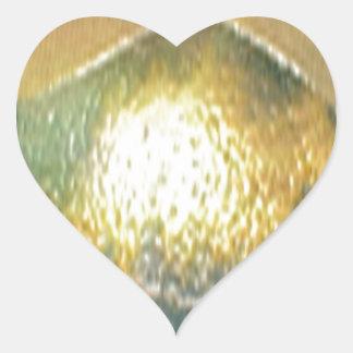 sand, gold green heart sticker