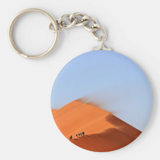 Sand Themed, Men Perched On The Ridge Of Blowing S Basic Round Button Key Ring