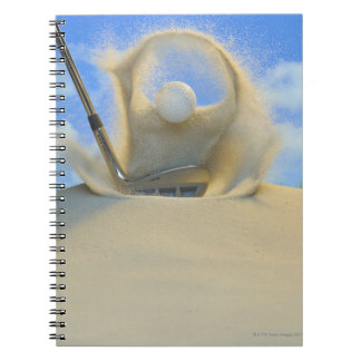sand wedge hitting a golf ball out of a sand 2 notebook