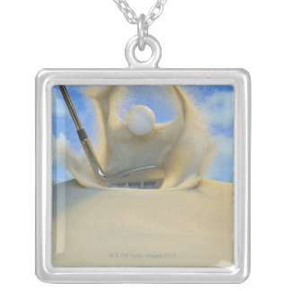 sand wedge hitting a golf ball out of a sand 2 silver plated necklace