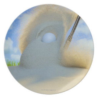 sand wedge hitting a golf ball out of a sand plate