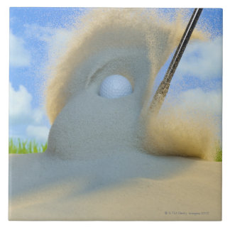 sand wedge hitting a golf ball out of a sand tile