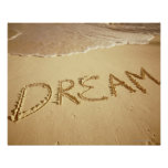 Sand writing 'Dream' with incoming surf at top Poster