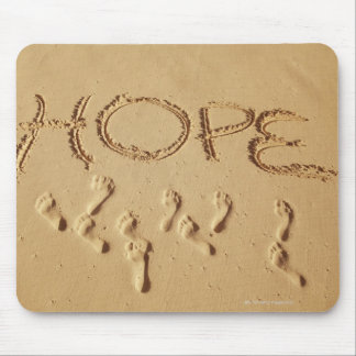 Sand writing ' Hope' on the beach with the Mouse Mat