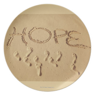 Sand writing ' Hope' on the beach with the Plate