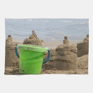 sandcastles on the beach tea towel