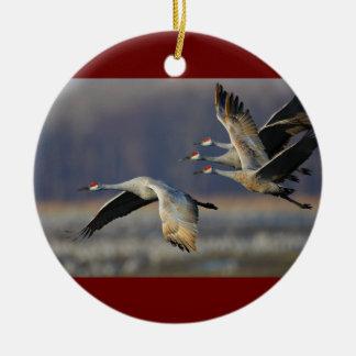 sandhill cranes in flight round ceramic decoration