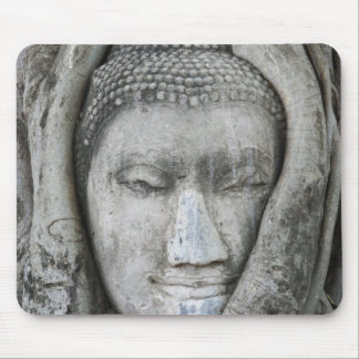 Sandstone head of Buddha surrounded by tree Mouse Mat