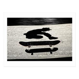 sandwiched skateboard postcard