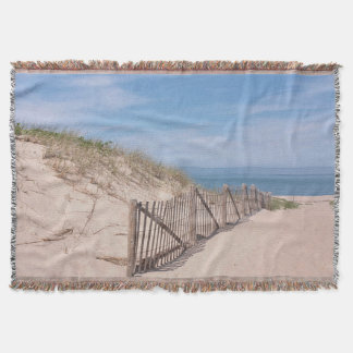 Sandy beach and ocean throw blanket