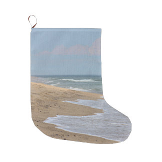 Sandy beach and ocean waves large christmas stocking