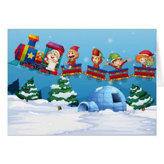 Santa and elf riding on train greeting card