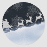 Santa and his reindeer round stickers