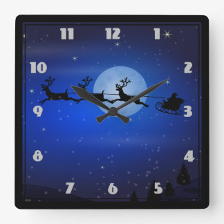 Santa and his reindeers flying at night wallclock