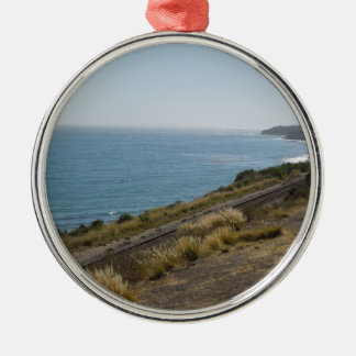 Santa Barbara Coastline with Railroad Tracks Round Metal Christmas Ornament