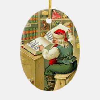 Santa Checking His List Ceramic Oval Decoration