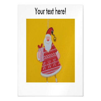 Santa Claus holding a gift Christmas decoration Magnetic Invitations
