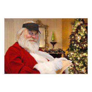 Santa Claus making hsi naughty and nice list print
